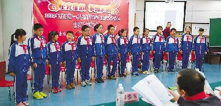 采荷一小教育集团大队委员改选答辩会现场。 记者 魏志阳 摄