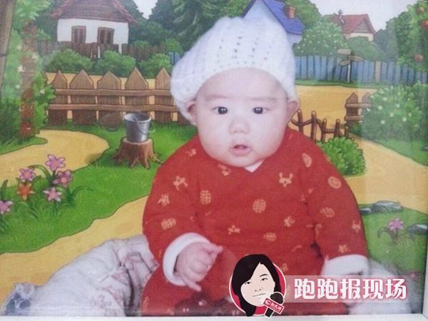 图说:失踪男婴的照片。新民网记者胡彦珣资料图