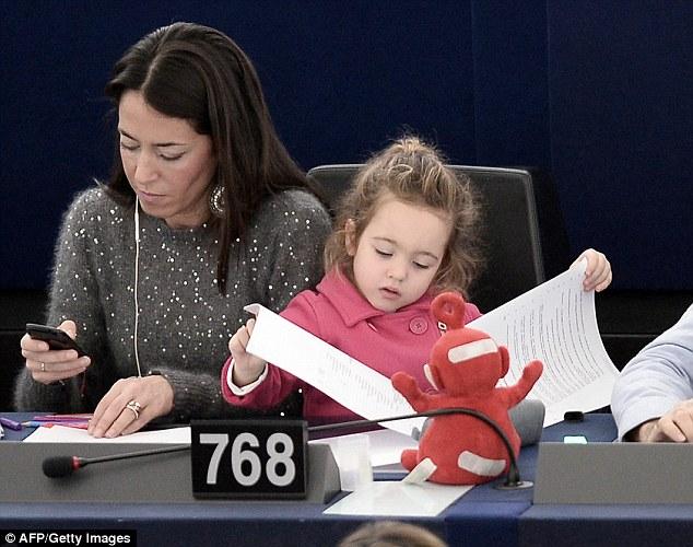Vittoria checks mummy\'s paperwork as Licia checks her Blackberry