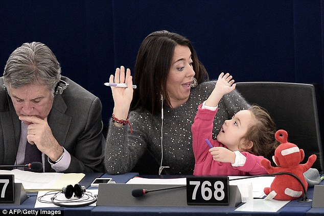Italy\'s Member of the European Parliament Licia Ronzulli takes part with her daughter in a vote yesterday