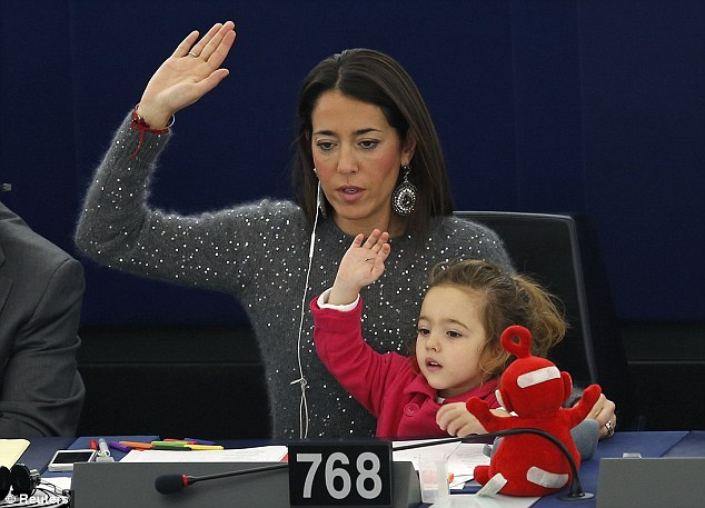 Not content with taking a back seat, Vittoria lifted her arm up along with her mother to vote