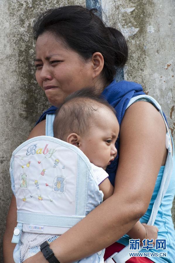 (国际)(2)菲律宾台风重灾区塔克洛班现场直击