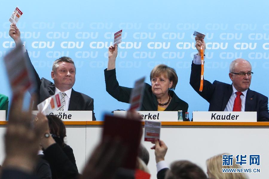 (国际)(1)德国基民盟表决通过联合组阁协议