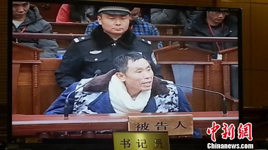 视频监控中,在法庭上受审的范杰明 徐明瑞 摄